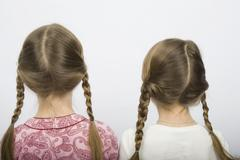 Two girls with pigtails Stock Photos