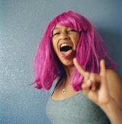 Teenage girl wearing a pink wig Stock Photos