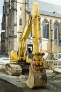 Stock Photo of A digger outside of a church