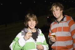Two young men drinking beer Stock Photos