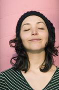 Stock Photo of A young woman with eyes closed