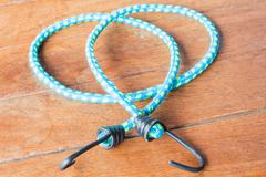 light blue rubber band with metal hooks - stock photo