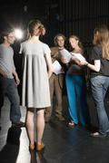 Actors rehearsing in a theater - stock photo