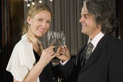 A couple toasting with champagne at a theater - stock photo