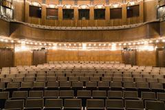 Empty seating in an illuminated art deco theater - stock photo