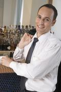 Businessman drinking espresso at a bar Stock Photos