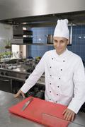 A chef in a commercial kitchen Stock Photos