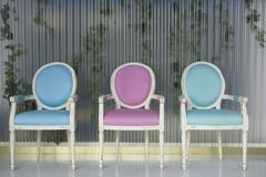 Three chairs in a row Stock Photos