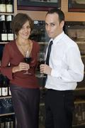 A couple wine tasting - stock photo