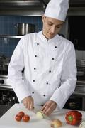 Stock Photo of A chef preparing vegetables