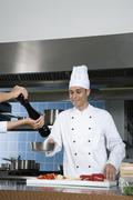 Chefs working in a kitchen - stock photo
