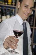 A man holding a glass of red wine Stock Photos