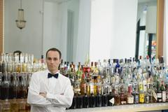 A bar tender standing at the bar Stock Photos