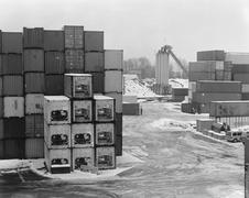 Cargo containers at a commercial dock in winter Stock Photos