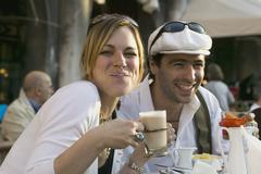 A couple sitting at a pavement cafe in Venice - stock photo