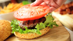 Hands Only Building Delicious Fresh Beef Burger Stock Footage