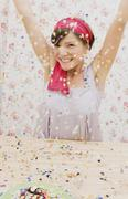 A young woman throwing confetti Stock Photos