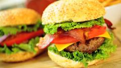 Close Up Classic Fresh Bacon Cheeseburger Meal Stock Footage