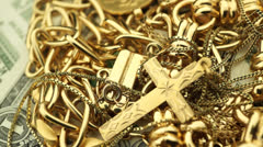 Gold Jewelry and Money turning Stock Footage