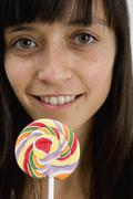 Stock Photo of A young woman with a lollipop