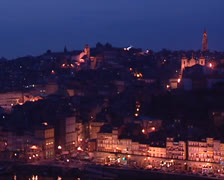 City of Porto, pan skyline at night, Episcopal Palace of Porto at horizon Stock Footage