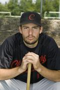 Portrait of a baseball player crouching with a baseball bat Stock Photos