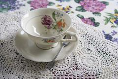 A cup and saucer on a table Stock Photos