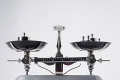Balance scales with metal weights Stock Photos