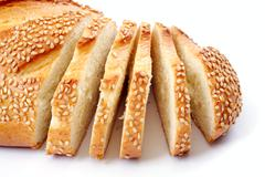 Bread with a sesame, over white Stock Photos