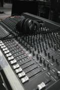 Headphones on an audio mixing board Stock Photos