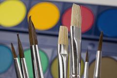 Paintbrushes and watercolor paints Stock Photos