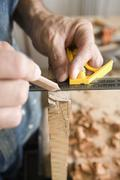 Detail of a carpenter measuring - stock photo