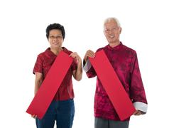 senior chinese new year couple - stock photo
