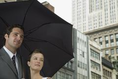 A bride and groom underneath an umbrella Stock Photos