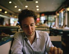 A man sitting in a diner - stock photo