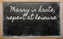 expression -  marry in haste, repent at leisure - written on a school blackbo - stock illustration