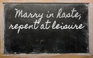 Stock Illustration of expression -  marry in haste, repent at leisure - written on a school blackbo