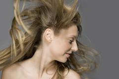 Air blowing through a fashion model's hair Stock Photos