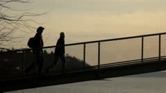 Silhouetted People Walking Across Staircase at Dusk Sunset Stock Footage