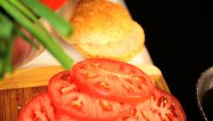 Organic Minced Beef Cooking Beside Sliced Salad Tomato - stock footage