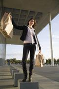 Stock Photo of A woman carrying shopping bags