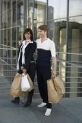 Stock Photo of A couple carrying shopping bags