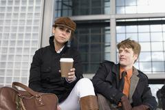 A couple resting in the city with a take away coffee Stock Photos