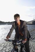 A businessman riding a bicycle Stock Photos