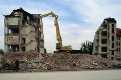 Mechanical digger demolishing a building Stock Photos