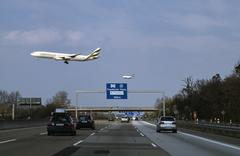 Aeroplanes flying over a motorway in Germany Stock Photos