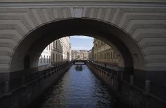 An archway over a canal in St Petersburg, Russia Stock Photos