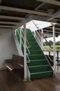 Steps on a boat leading to the deck above Stock Photos