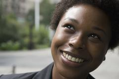 Woman looking up and smiling Stock Photos