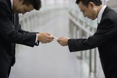 Japanese businessmen exchanging business cards Stock Photos